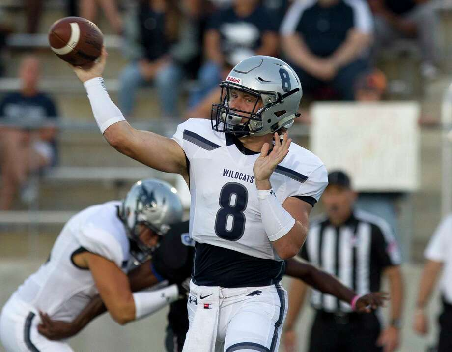 Tomball Memorial quarterback Dru Baker (8) throws a pass during the first quarter of a non-district high school football game against New Caney at Texan Drive Stadium, Friday, Sept. 8, 2017, in New Caney. Photo: Jason Fochtman, Staff Photographer / Internal