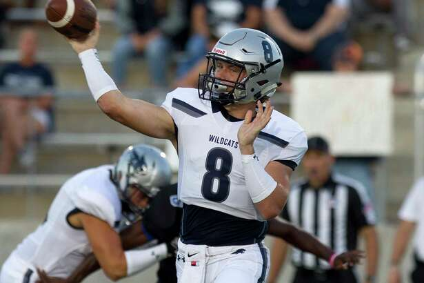 Tomball Memorial quarterback Dru Baker (8) throws a pass during the first quarter of a non-district high school football game against New Caney at Texan Drive Stadium, Friday, Sept. 8, 2017, in New Caney.