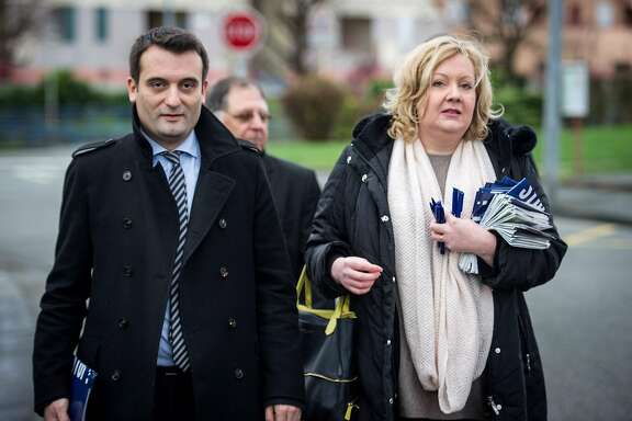 """(FILES) This file photo taken on December 1, 2015 shows Florian Philippot (L), top French far-right Front National (FN) party candidate for the French regional elections in the Alsace-Champagne-Ardenne-Lorraine region, and Sophie Montel, FN top candidate for the regional elections for the Bourgogne Franche-Comte region, walking in a street in Delle, eastern France. Sophie Montel declared that she would follow Florian Philippot, the leader of the far right-wing French National Front party and considered the right arm of Marine Le Pen, who announced on September 21, 2017, that he had """"left"""" the formation, a sign of tensions within the party since their failure in the May 2017 presidential election. / AFP PHOTO / SEBASTIEN BOZONSEBASTIEN BOZON/AFP/Getty Images"""