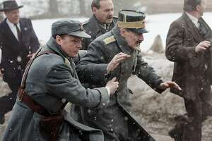 """Jesper Christensen, second from right, portrays King Haakon VII of Norway in the World War II drama """"The King's Choice."""""""