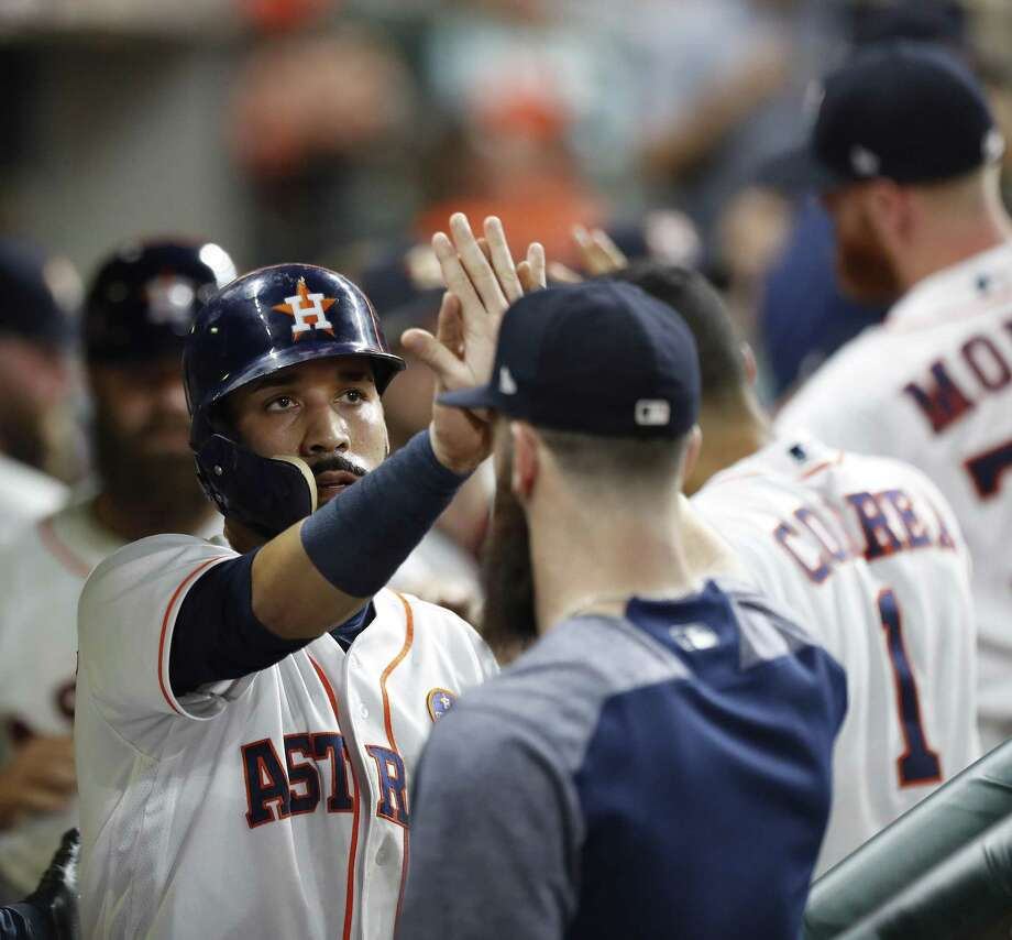Astros' Marwin Gonzalez (left) celebrates his run scored on Yuli Gurriel's RBI double during the fourth inning against the Chicago White Sox at Minute Maid Park on Sept. 20, 2017, in Houston. Photo: Karen Warren /Houston Chronicle / @ 2017 Houston Chronicle