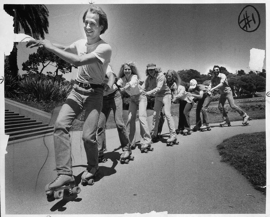 Roller skaters form a conga line in July 1978. A combination of disco music and polyurethane wheels created a skating craze in San Francisco in the late 1970s. Photo: Gary Fong, The Chronicle