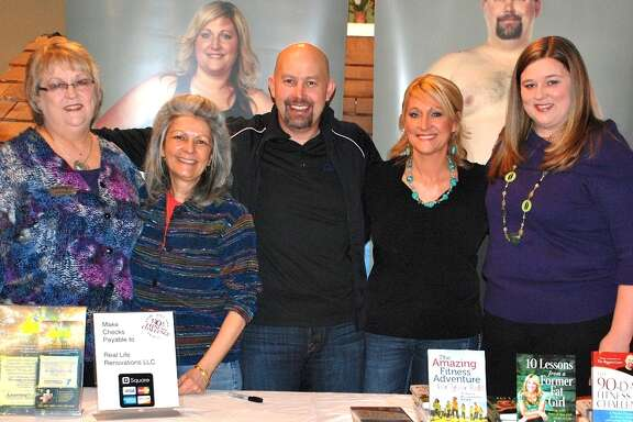 "Angela Colton, executive director for The Woodlands Children's Museum, second from left, stands with Phil and Amy Parham, center, and event sponsor Beth Buzbee, left, and Kim Bellini, right, of Learning Rx located in The Woodlands. The museum is part of First Lady Michelle Obama's ""Let's Move"" initiative against childhood obesity and will feature a variety of classes this month as part of The Woodlands Children's Museum ""Get Fit"" month. For more information on The Woodlands Children's Museum, visit www.woodlandschildrensmuseum.org or call 281-465-0955. The Woodlands Children's Museum is located at 4775 W. Panther Creek in The Woodlands next to Sears Hardware."