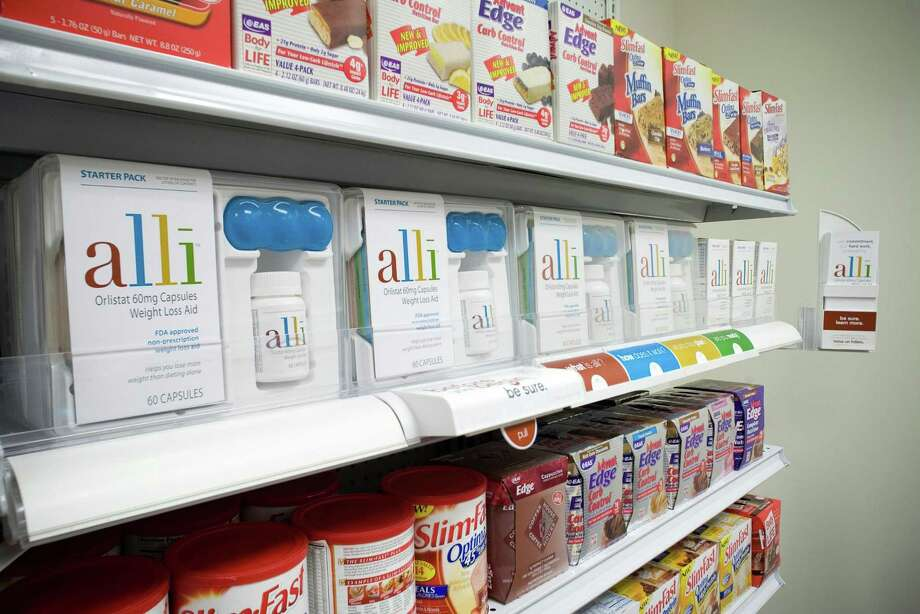 GSK packages of Alli on display, with the drug having been manufactured at an Aiken, S.C. plant being acquired by Norwalk, Conn.-based Avara Pharmaceuticals for future use as an outsourced drug production and packaging facility in a deal announced Sept. 21, 2017. (PRNewsFoto/GlaxoSmithKline Consumer Healthcare) Photo: / PR NEWSWIRE / 2007 Terry Clark Photography