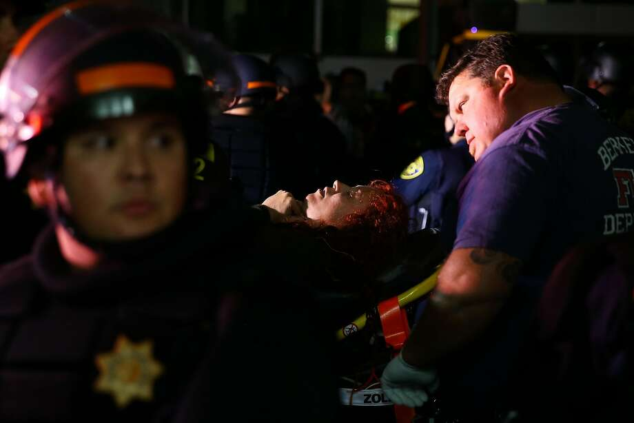 An attendee who fell after Ben Shapiro's UC Berkeley and was carried out on a stretcher. Photo: ELIJAH NOUVELAGE, AFP/Getty Images