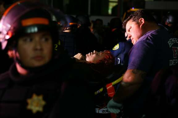 CORRECTION - A supporter of conservative commentator Ben Shapiro is carried on a stretcher after she took a fall to the ground following a speech by Shapiro, September 14, 2017 at the University of California, Berkeley.  / AFP PHOTO / Elijah Nouvelage / The erroneous mention[s] appearing in the metadata of this photo by Elijah Nouvelage has been modified in AFP systems in the following manner: [after she took a fall] instead of [fell during a scuffle with protesters]. Please immediately remove the erroneous mention[s] from all your online services and delete it (them) from your servers. If you have been authorized by AFP to distribute it (them) to third parties, please ensure that the same actions are carried out by them. Failure to promptly comply with these instructions will entail liability on your part for any continued or post notification usage. Therefore we thank you very much for all your attention and prompt action. We are sorry for the inconvenience this notification may cause and remain at your disposal for any further information you may require.ELIJAH NOUVELAGE/AFP/Getty Images