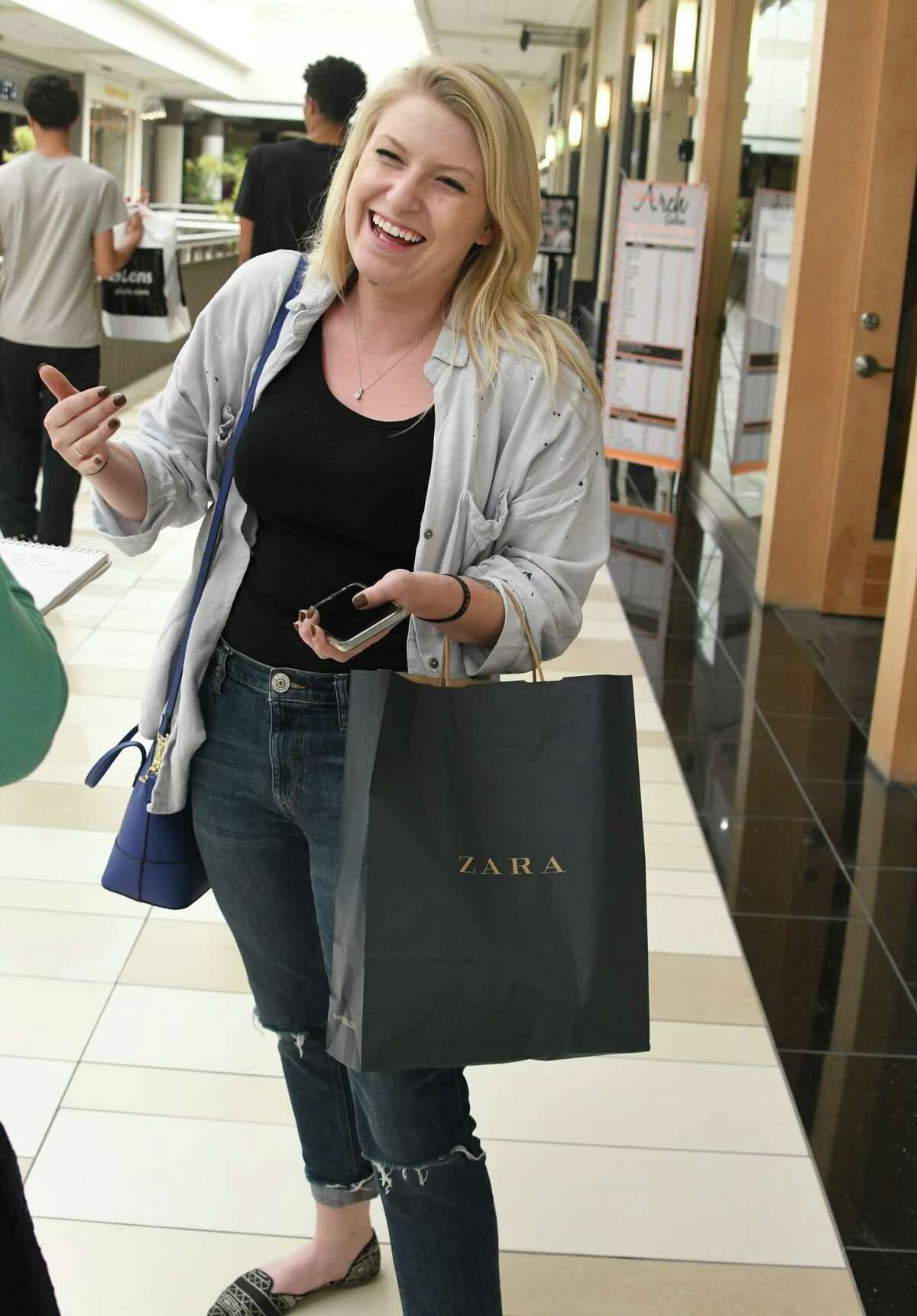 Taylor Matthews of Scotia talks about what she bought at Zara on opening day at Crossgates Mall on Thursday, Sept. 21, 2017 in Albany, N.Y. Zara is a two-level European fashion store. (Lori Van Buren / Times Union)