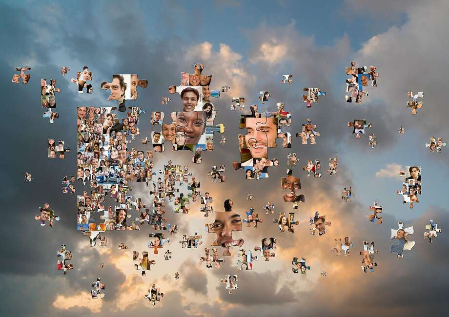 Puzzle pieces with smiling faces floating in cloudy sky Photo: John Lund, Getty Images/Blend Images