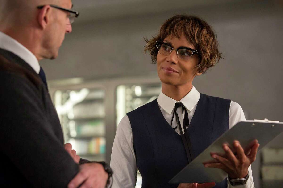 This image released by Twentieth Century Fox shows Mark Strong, left, and Halle Berry in