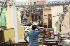 """SAN JUAN, PUERTO RICO - SEPTEMBER 21:  Damaged homes in the La Perla neighborhood the day after Hurricane Maria made landfall on September 21, 2017 in San Juan, Puerto Rico. The majority of the island has lost power, in San Juan many are left without running water or cell phone service, and the Governor said Maria is the """"most devastating storm to hit the island this century."""" (Photo by Alex Wroblewski/Getty Images)"""