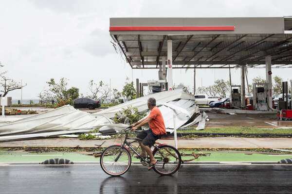 "SAN JUAN, PUERTO RICO - SEPTEMBER 21: A damaged gas station the day after Hurricane Maria made landfall on September 21, 2017 in San Juan, Puerto Rico. The majority of the island has lost power, in San Juan many are left without running water or cell phone service, and the Governor said Maria is the ""most devastating storm to hit the island this century."" (Photo by Alex Wroblewski/Getty Images)"