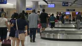 Travelers wait for their luggage after arriving at the San Antonio International Airport in 2015. The airport received a mixed customer satisfaction ranking in the latest J.D. Power survey measuring customer satisfaction at U.S. airports.