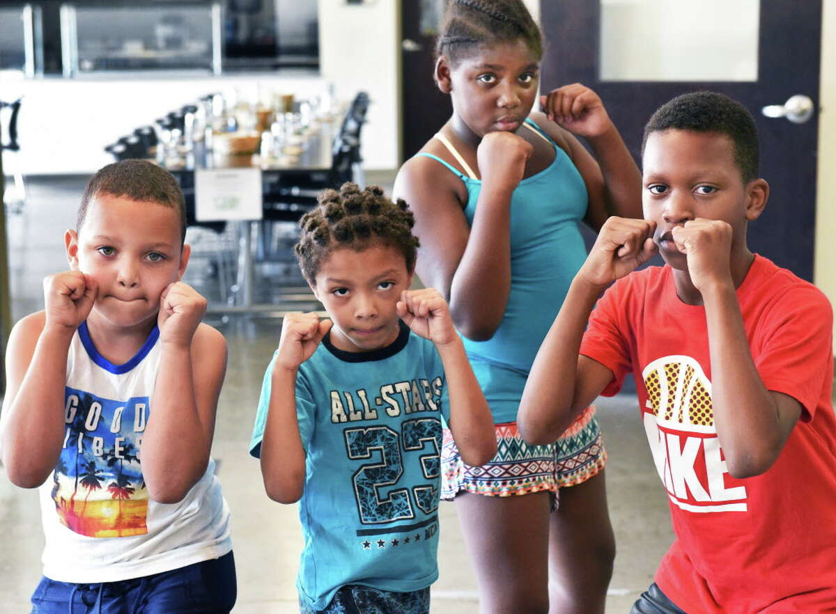 Children, from left, Zyien Reid, 8, Ryan Hickey, 6, Azaria Frazier, 10, and Trevonte Vantry, 9, in the boxing program at Unity House Wednesday August 30, 2017 in Troy, NY. (John Carl D'Annibale / Times Union)