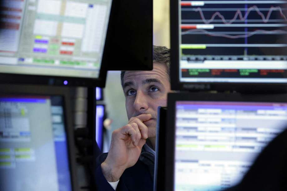 Specialist Anthony Rinaldi works at his post on the floor of the New York Stock Exchange in January. The Federal Reserve said Thursday Americans' net worth rose 1.8 percent to $96.2 trillion in the April-June quarter. Photo: Associated Press File Photo / AP