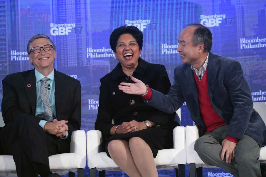 PepsiCo CEO Indra Nooyi flanked on Sept. 20, 2017, between billionaire Bill Gates (L) and SoftBank CEO Masayoshi Son. On Sept. 21, Fortune named Nooyi the second most powerful woman in business for a third consecutive year, behind General Motors CEO Mary Barra. (Photo by John Moore/Getty Images) Photo: John Moore / Getty Images / 2017 Getty Images
