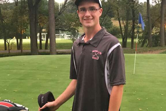 In this Tuesday, Sept. 19, 2017 photo, Ben Tetzlaff, a Parkland High senior, poses for a photo at Iron Lakes Country Club in Allentown, Pa. Tetzlaff defied huge odds by recording two holes-in-one in the same round on Monday, Sept. 18. (Mark Wogenrich/The Morning Call via AP)