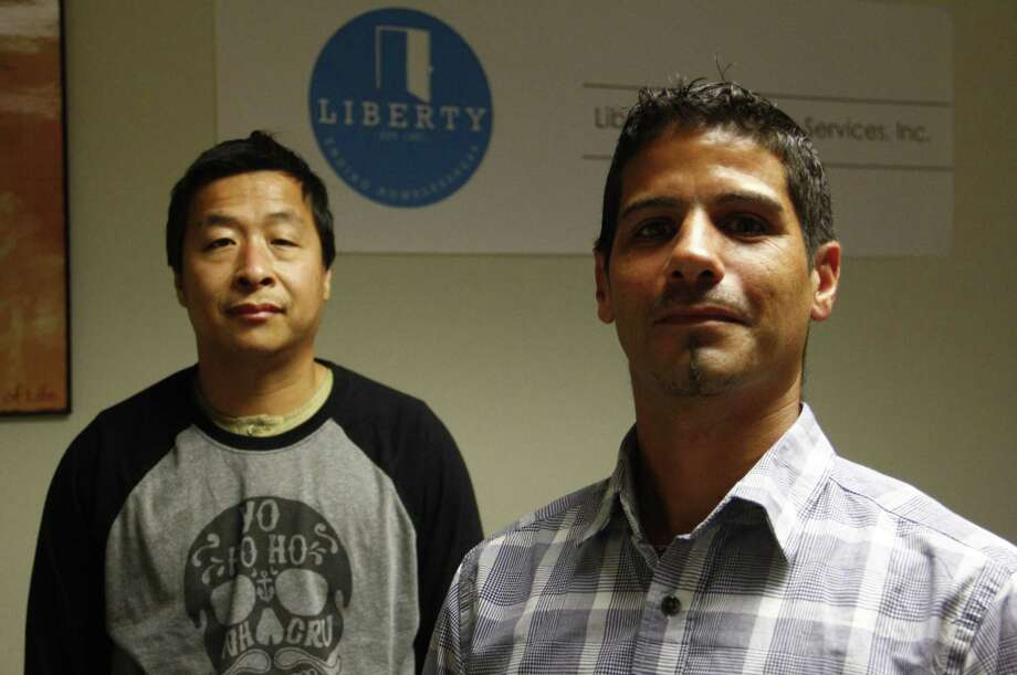 Ben Morrill, 45, (left) and Santos Perez, 44, stand inside the Liberty Community Services offices on Thursday, Sept. 21, in New Haven. Morrill and Perez are both participating in a program providing them with temporary work opportunities. Photo: Esteban L. Hernandez / Hearst