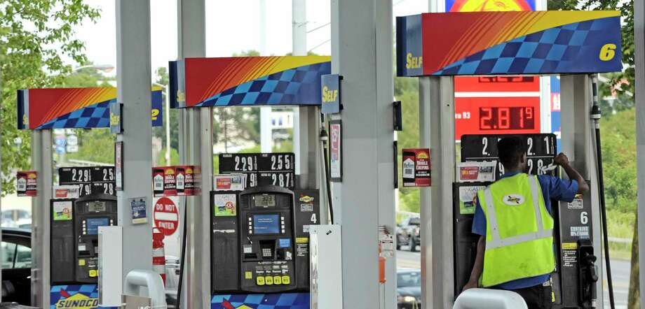 A worker changes the price board above the gas pumps at a Sunoco gas station on Monday, Aug. 28, 2017, in Latham, N.Y.  (Paul Buckowski / Times Union) Photo: Robin Cornett, STAFF PHOTOGRAPHER / 20041402A