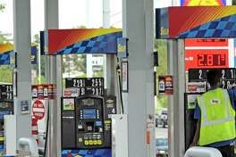 A worker changes the price board above the gas pumps at a Sunoco gas station on Monday, Aug. 28, 2017, in Latham, N.Y.  (Paul Buckowski / Times Union)