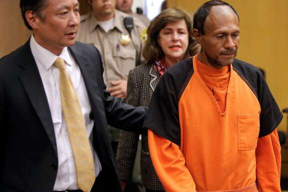 San Francisco Public Defender Jeff Adachi, (left) leads Juan Francisco Lopez-Sanchez, into the Hall of Justice in San Francisco, Calif. on Tues. July 7, 2015, for his arraignment on suspicion of murder in the shooting death of Kate Steinle on San Francisco's Pier 14 last Wednesday.