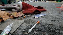 A syringe is seen discarded near a homeless encampment along Berry St. south of Market Street in San Francisco, California, on Tuesday November 1, 2016.