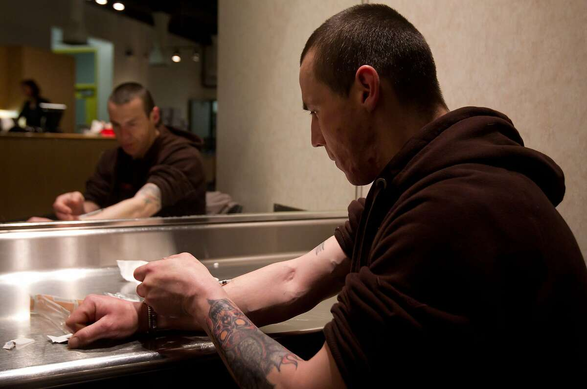 In this 2011 file photo, a user injects heroin he bought on the street at the Insite safe injection clinic in Vancouver, B.C.