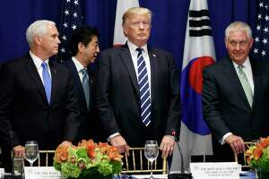 Japanese Prime Minister Shinzo Abe walks to his seat at a luncheon with President Donald Trump and South Korean President Moon Jae-in at the Palace Hotel during the United Nations General Assembly, Thursday, Sept. 21, 2017, in New York. From left, Vice President Mike Pence, Abe, Trump, and Secretary of State Rex Tillerson. (AP Photo/Evan Vucci)