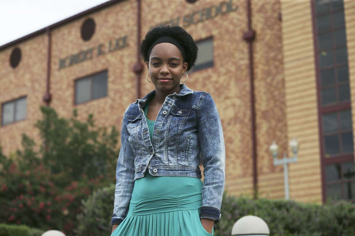 Robert E. Lee High School student Kayla Wilson stands in front of her school, whose name she sought to change, on June 30, 2015. American history must include the good, the bad and the ugly, one reader says, and changing the name of the school does not alter the past.