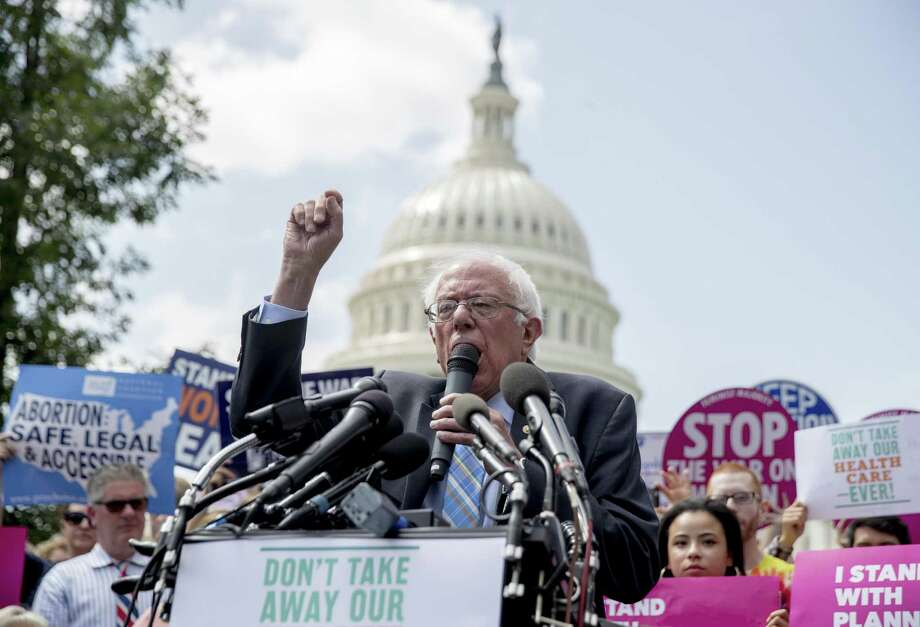 "Sen. Bernie Sanders speaks at a rally of health care advocates, grassroots activists, and others outside the Capitol on Tuesday. Sanders pursues a ""Medicare for all"" bill while Senate Republicans begin another push to repeal the Affordable Care Act with the Graham-Cassidy proposal. Photo: Andrew Harnik /Associated Press / Copyright 2017 The Associated Press. All rights reserved."