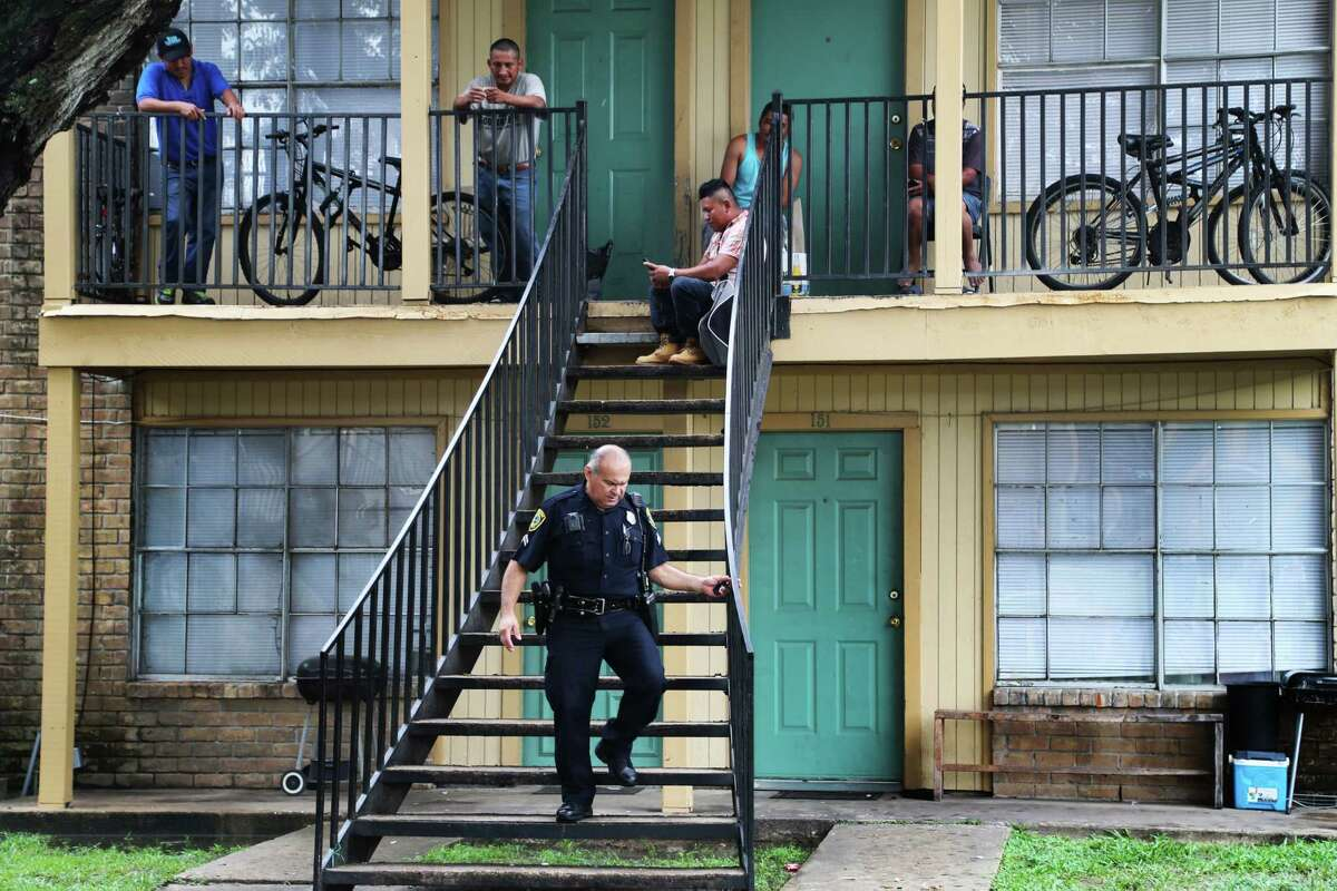 """Houston Police Department officer Al Yanez, 51, walks down the stairs of an apartment building, Tuesday, Aug. 8, 2017, after answering questions about the Texas law, known as Senate Bill 4, which bans ?'sanctuary cities.?"""" The law will take effect Sept. 1. ( Marie D. De Jesus / Houston Chronicle )"""