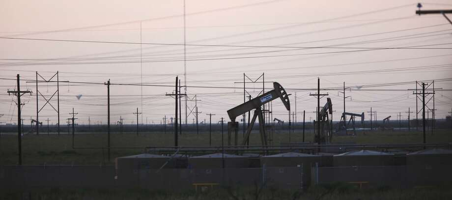 Power lines and pump jacks dot the horizon in the Permian Basin just west of Midland, Texas, Tuesday, July 24, 2012. A new report from the research and consulting firm Wood Mackenzie says that drillers in the Permian Basin, who have poured into the field in West Texas and eastern New Mexico at breakneck speed, risk bumping into the limits of the field's geology in a few years. Photo: Jerry Lara /San Antonio Express-News / © 2012 San Antonio Express-News
