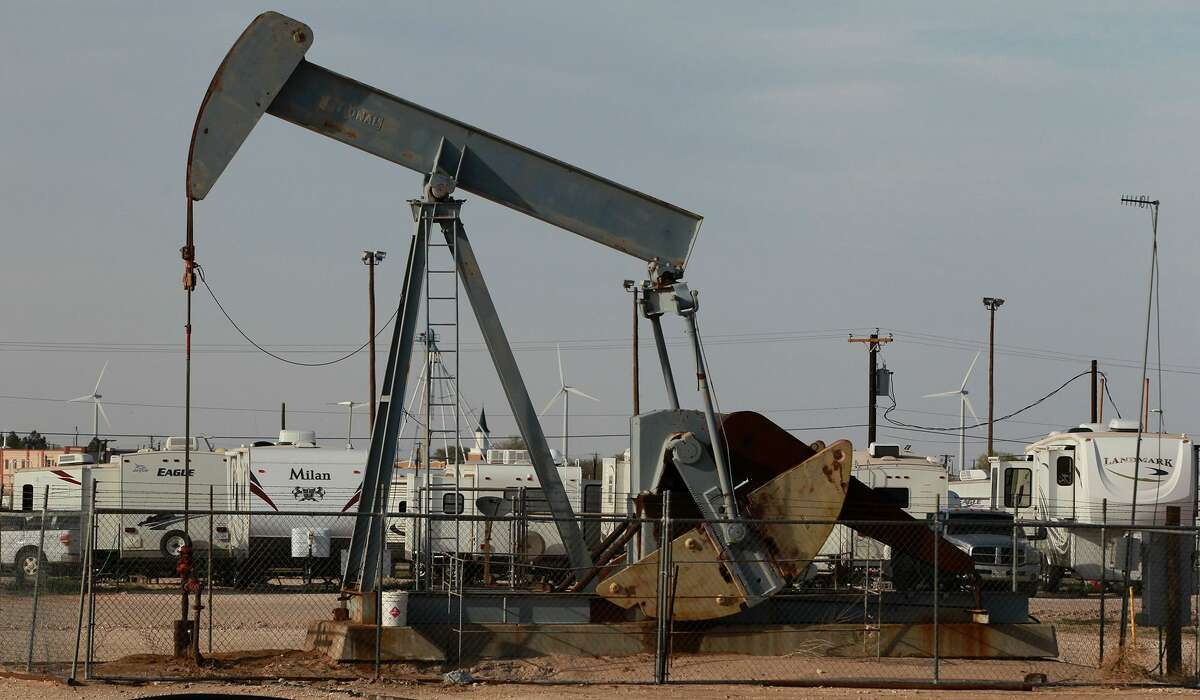 A pumpjack rocks back and forth Wednesday April 2, 2014 in Stanton, Texas next to the Permian Basin Golf & RV Park where people in the petroleum industry live. The United States is producing record volumes of oil, with nearly one-third of it coming from the Permian Basin.
