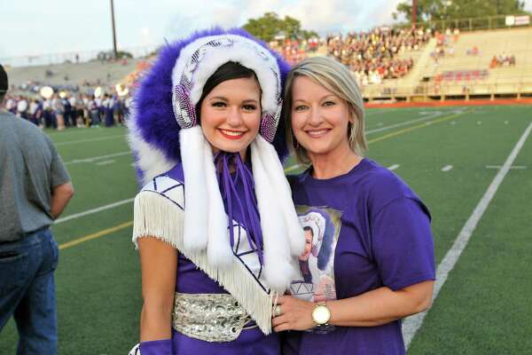Members of the Port Neches-Groves Indians Marching Band, Indianettes, Twirlers and other student groups stand with their parents during Parents' Night ceremonies before the start of Wednesday's game with the Lumberton Raiders at Indian Stadium in Port Neches. (Mike Tobias/The Enterprise)