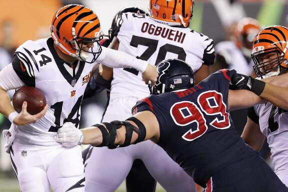 Houston Texans defensive end J.J. Watt (99) pressures Cincinnati Bengals quarterback Andy Dalton (14) during the fourth quarter of an NFL football game at Paul Brown Stadium on Thursday, Sept. 14, 2017, in Cincinnati. ( Brett Coomer / Houston Chronicle )