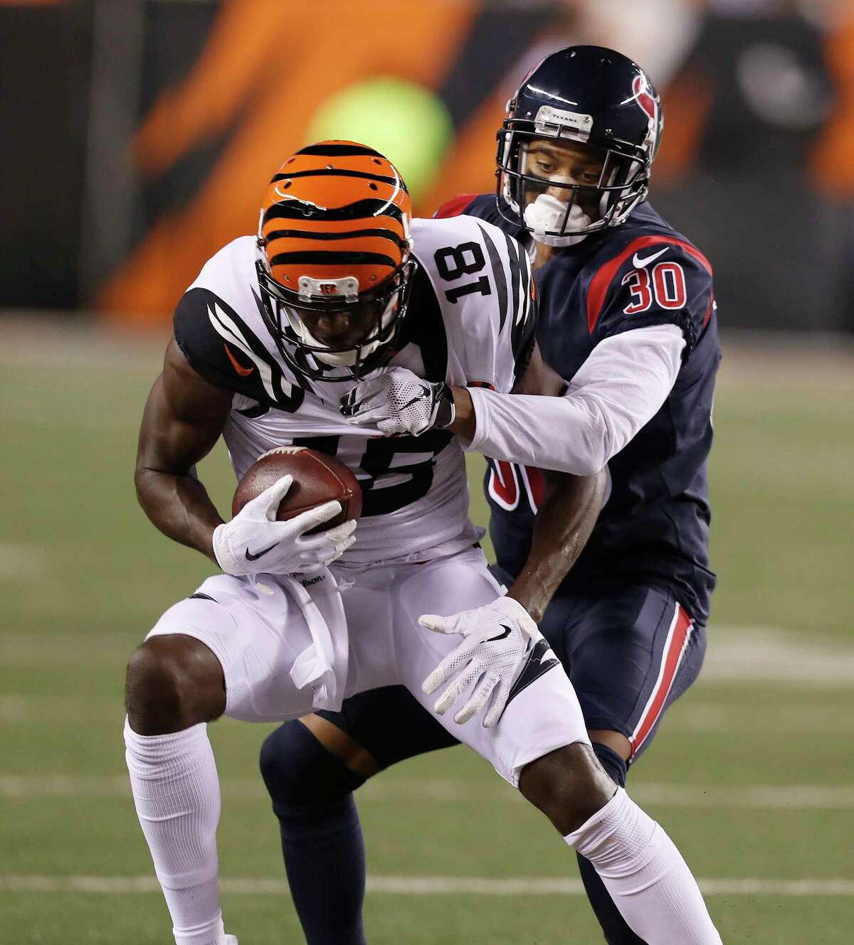 Cincinnati Bengals wide receiver A.J. Green (18) tries to get loose from Houston Texans cornerback Kevin Johnson (30) during the second quarter of an NFL football game at Paul Brown Stadium on Thursday, Sept. 14, 2017, in Cincinnati. ( Brett Coomer / Houston Chronicle )