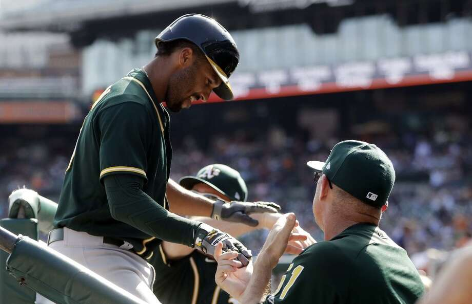 Marcus Semien is greeted after hitting a two-run homer run against Detroit on Wednesday. Photo: Carlos Osorio / Carlos Osorio / Associated Press / Copyright 2017 The Associated Press. All rights reserved.