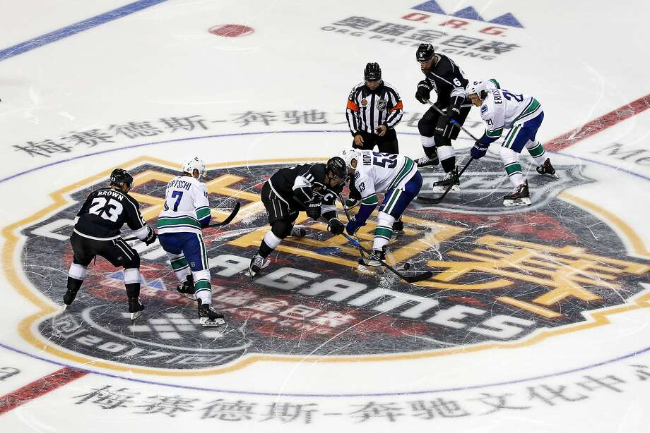 The Los Angeles Kings and Vancouver Canucks face-off in Shanghai during the NHL's first preseason game in China. Photo: Associated Press