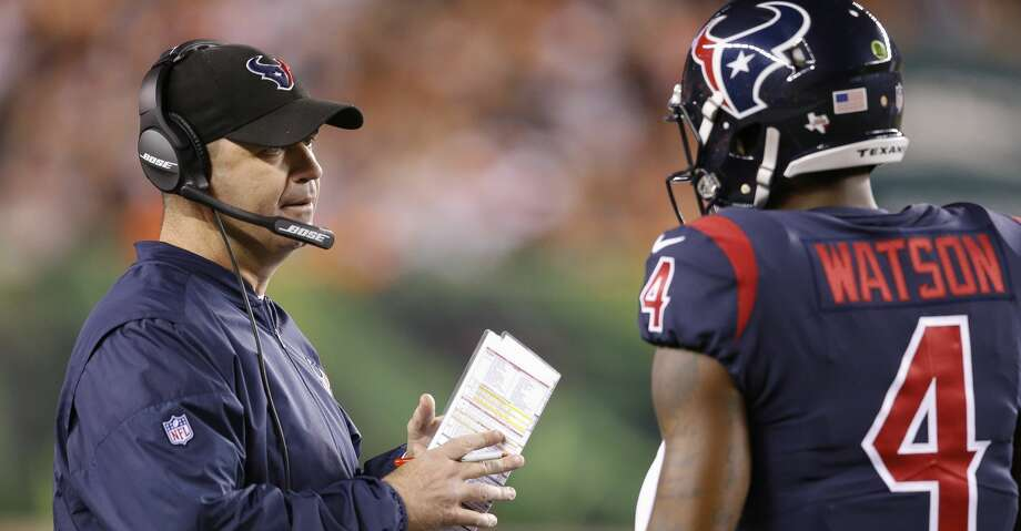 Houston Texans coach Bill O'Brien, left, speaks with quarterback Deshaun Watson (4) during the first half of an NFL football game against the Cincinnati Bengals, Thursday, Sept. 14, 2017, in Cincinnati. (AP Photo/Gary Landers) Photo: Gary Landers/Associated Press