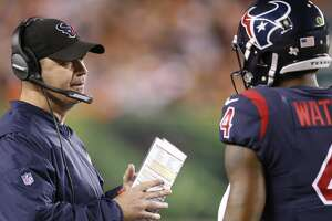 Houston Texans coach Bill O'Brien, left, speaks with quarterback Deshaun Watson (4) during the first half of an NFL football game against the Cincinnati Bengals, Thursday, Sept. 14, 2017, in Cincinnati. (AP Photo/Gary Landers)