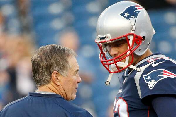 FOXBORO, MA - AUGUST 31: Bill Belichick of the New England Patriots and Tom Brady #12 chat before a preseason game with the New York Giants at Gillette Stadium on August 31, 2017 in Foxboro, Massachusetts. (Photo by Jim Rogash/Getty Images)