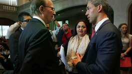 San Antonio Mayor Ron Nirenberg, right, and Bexar County Judge Nelson Wolff, left, speak with Mexico Consulate General Reyna Torrez Mendivil, center, about how San Antonians can help in community-wide earthquake relief efforts for Mexico, on Thursday, Sept. 21, 2017, in the City Council Chambers. The Consulate General made a formal presentation to the city council.