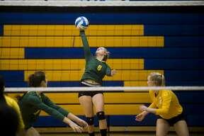 Dow sophomore Jenna Somers serves the ball during Dow's game against Arthur Hill on Thursday, September 21, 2017 at Midland High School. (Katy Kildee/kkildee@mdn.net)