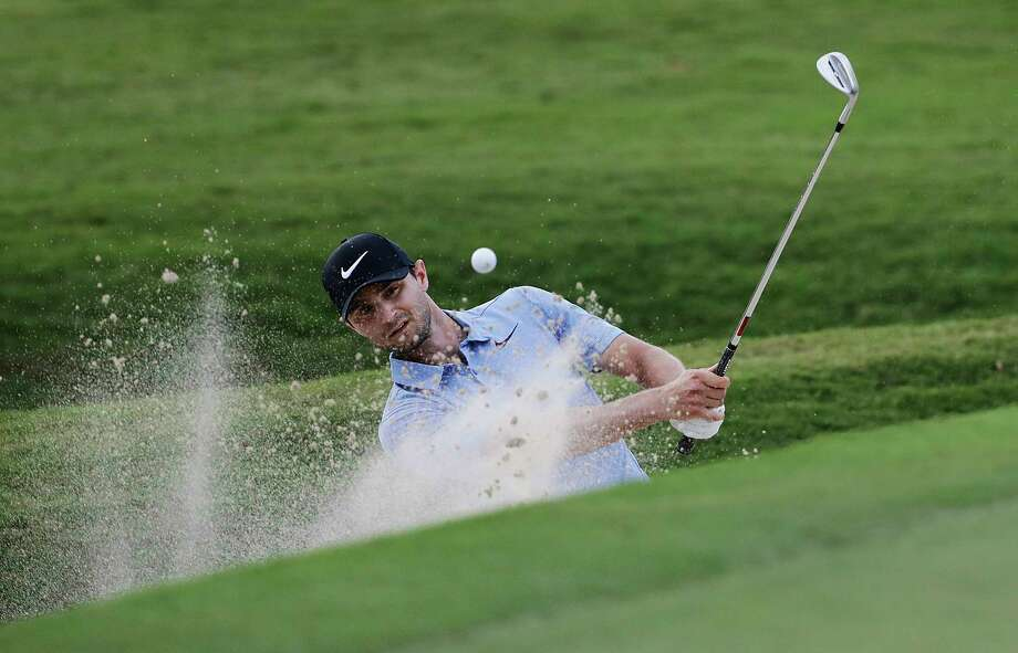 Kyle Stanley hits out of the bunker on the 18th hole during the first round of the Tour Championship golf tournament at East Lake Golf Club in Atlanta, Thursday, Sept. 21, 2017. (AP Photo/David Goldman) Photo: David Goldman, STF / Copyright 2017 The Associated Press. All rights reserved.