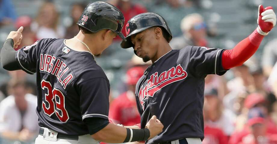 ANAHEIM, CA - SEPTEMBER 21:  Francisco Lindor #12 and Giovanny Urshela #39 of the Cleveland Indians celebrate after both score on Lindor's three run home run in the fifth inning against the Los Angeles Angels of Anaheim on September 21, 2017 at Angel Stadium of Anaheim in Anaheim, California.  (Photo by Stephen Dunn/Getty Images) Photo: Stephen Dunn/Getty Images