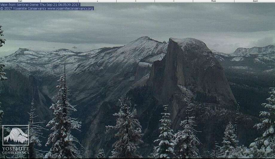 This webcam image provided by the Yosemite Conservancy on Thursday shows Half Dome in Yosemite National Park with a dusting of snow. Snow and hail brought winter driving conditions to the Sierra on the last full day of summer led to a fatal 16-car collision on Interstate 80. Photo: Associated Press