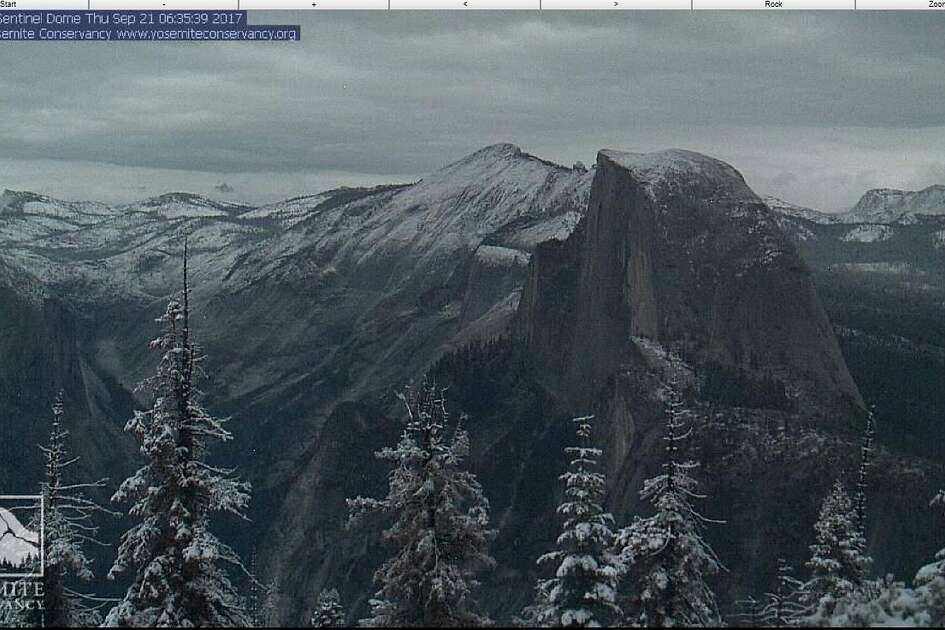 In this Sept. 21, 2017, webcam image by Yosemite Conservancy at yosemiteconservancy.org shows Half Dome, a granite dome at the eastern end of Yosemite Valley in Yosemite National Park, Calif. Snow fell in the Sierra Nevada on the last day of summer, giving the towering mountain range shared by California and Nevada a wintry look in September and making travel hazardous. Snow dusted peaks in Yosemite National Park and temporarily closed Tioga Pass road, the soaring eastern entry to the park that typically doesn't become impassable until mid-November. (Webcam by Yosemite Conservancy at yosemiteconservancy.org via AP)