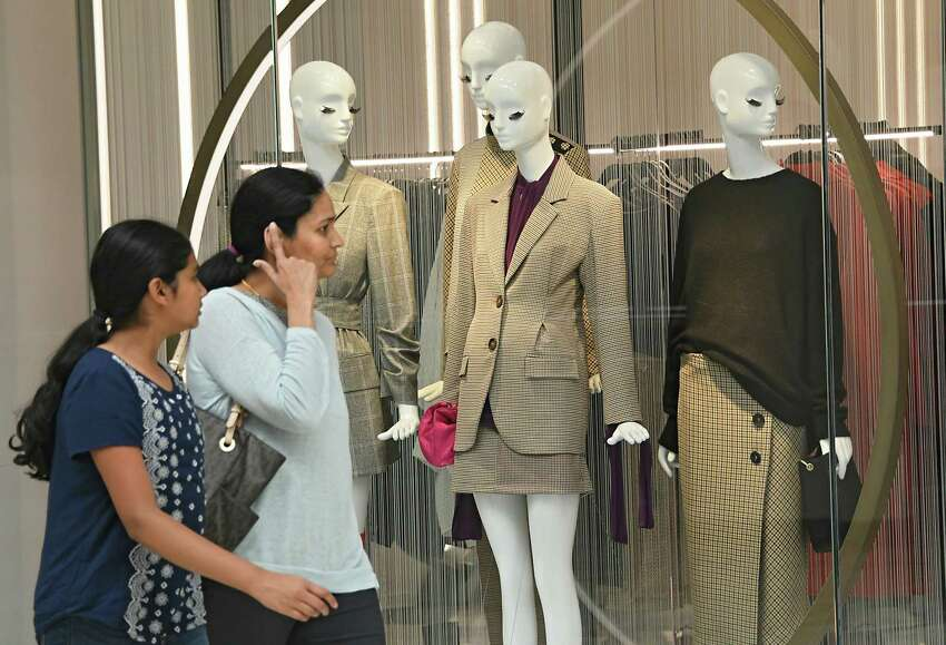 Shoppers look at mannequins in the window of the upstairs Zara on opening day at Crossgates Mall on Thursday, Sept. 21, 2017 in Albany, N.Y. Zara is a two-level European fashion store. (Lori Van Buren / Times Union)