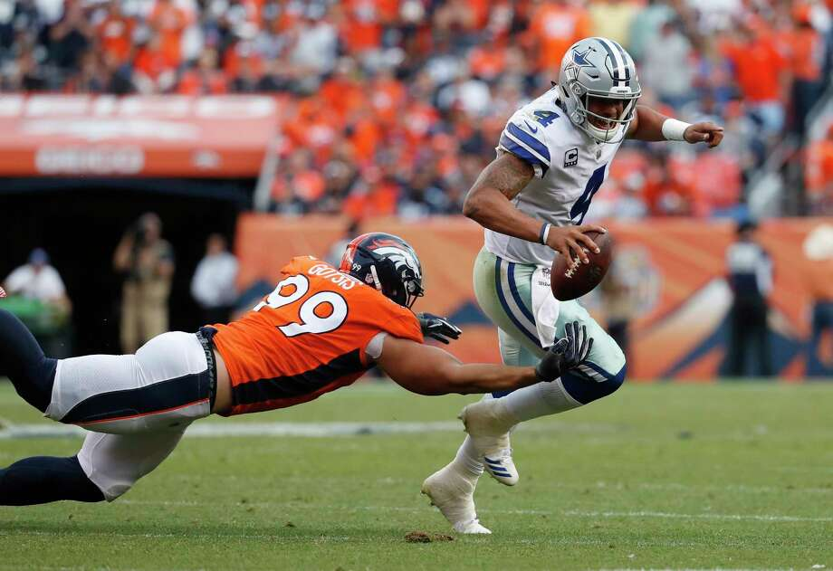 Dallas Cowboys quarterback Dak Prescott scrambles away from Denver Broncos defensive end Adam Gotsis (99) during the second half of an NFL football game, Sunday, Sept. 17, 2017, in Denver. (AP Photo/Jack Dempsey) Photo: Jack Dempsey, FRE / FR42408 AP