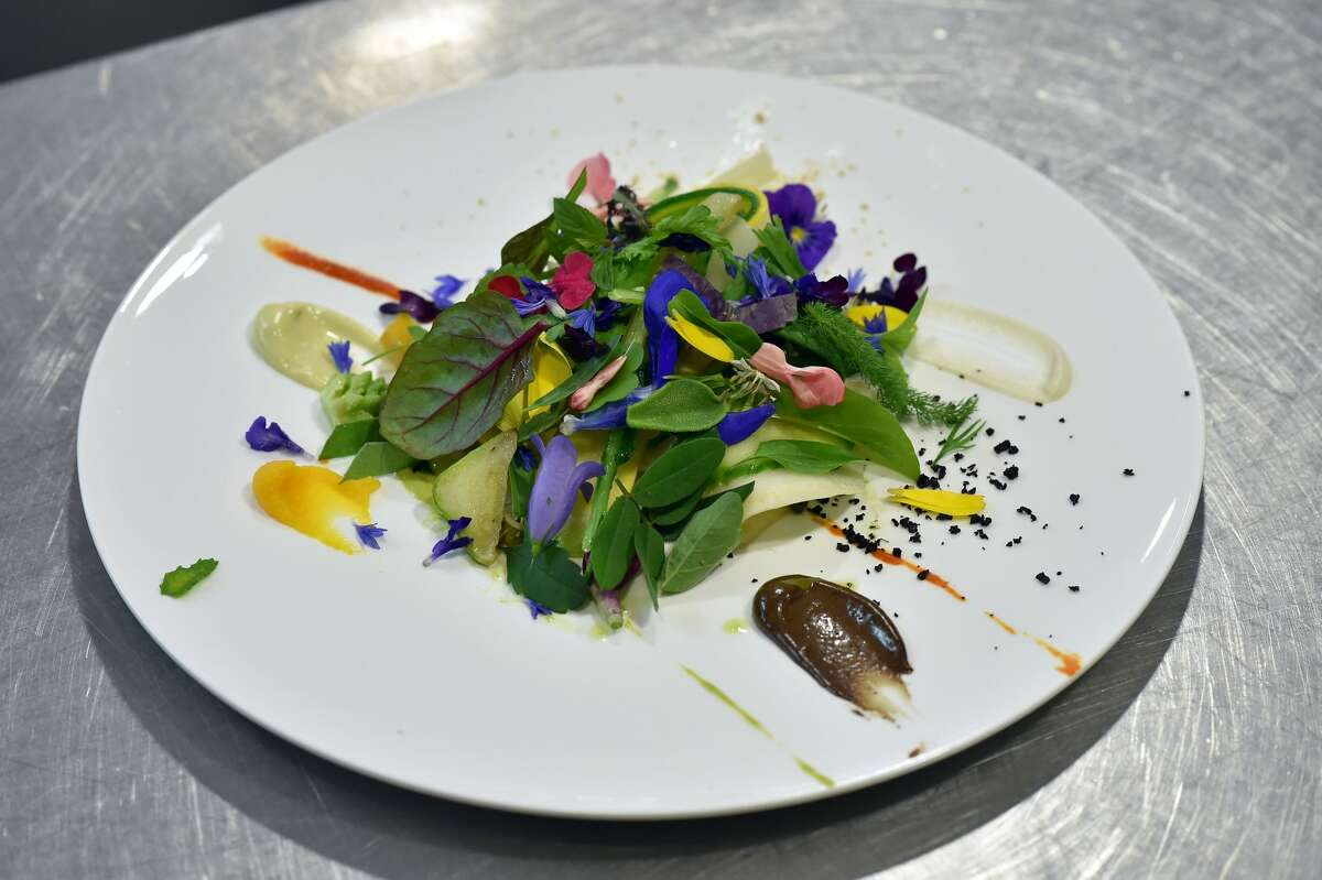 """A picture taken in the three-star restaurant Le Suquet, in Laguiole, southern France, on September 21, 2017, shows a dish called """"Le Gargouillou"""", after the chef Sebastien Bras announced that he asked not to be included in the Michelin Guide starting in 2018."""