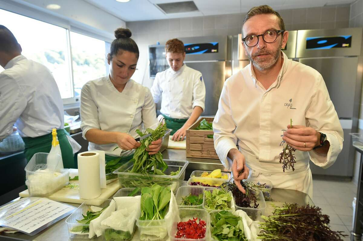 French chef Sebastien Bras prepares food in the kitchen of his three-star restaurant Le Suquet, in Laguiole, southern France, on September 21, 2017, after announcing that he asked not to be included in the Michelin Guide starting in 2018.